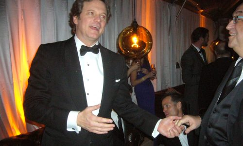 Colin Firth being congratulated on his Golden Globe win at an after-party