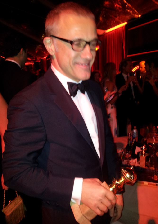 Another camera-phone snafu as Christoph Waltz thought the focusing light was the flash!