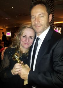 Les Miserables producer Debra Hayward celebrating the film's big win with friend Jason Isaacs at the HBO party.