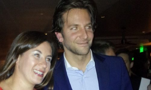 Bradley Cooper posing for a photograph with a fan from Germany.