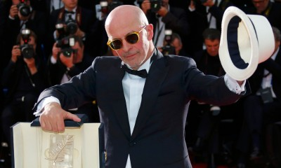 Jacques Audiard showing off his Palme d'Or. And his hat. Photograph: Yves Herman/Reuters